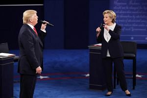 US Democratic presidential nominee Hillary Clinton and Republican presidential nominee Donald Trump at the town hall debate at Washington University on Oct 9, 2016.