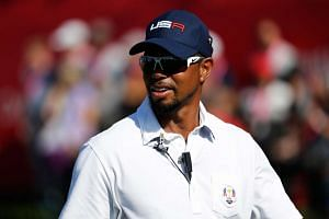 Vice-captain Tiger Woods of the United States looks on from the first tee during singles matches of the 2016 Ryder Cup at Hazeltine National Golf Club on Oct 2, 2016 in Chaska, Minnesota.