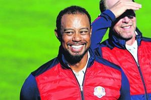Vice-captain Tiger Woods of the United States looks on during team photocalls prior to the 2016 Ryder Cup at Hazeltine National Golf Club on Sept 27, 2016 in Chaska, Minnesota.