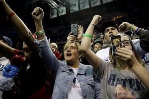 Donald Trump supporters cheer at a campaign rally in Wilkes-Barre, Pennsylvania.