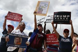 Supporters of Republican presidential nominee Donald Trump show their support for him before the start of the campaign event for Democratic presidential nominee Hillary Clinton at the Miami Dade College - Kendall Campus, Theodore Gibson Center on Oct