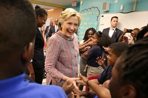 Hillary Clinton speaks to children at Overtown Youth Centre in Miami, Florida.