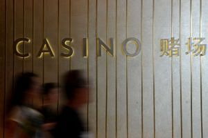 People walking past the casino at Marina Bay Sands.