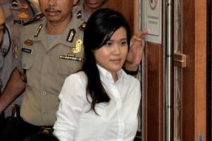 Jessica Kumala Wongso enters the courtroom prior to her trial at the Central Jakarta court on Oct 5, 2016.
