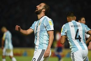 Argentina's Gonzalo Higuain reacts in dejection after failing a shot during the qualifier on Oct 11, 2016.