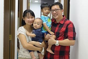 Mr Loi, a church worker, with his wife Chiam Mei Si, 32, and their sons Zhen Yi, three, and Zhen An, 101/2 months. Zhen Yi was conceived when the couple were living with Mr Loi's parents after their marriage.