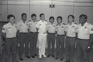 Above: Mr Ledger (fourth from left) in a 1983 photo with members of the cable car rescue team. Right: The 60-year-old, who has since retired from active duty as a commodore, was invited to aluncheon for PM Lee yesterday.