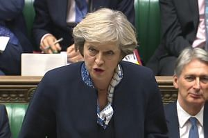 British Prime Minister Theresa May as she speaks during Prime Minister's Questions (PMQs) in the House of Commons in London on Oct 12, 2016.