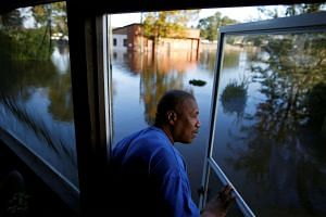 Eric McClary checks on his flooded home after the effects of Hurricane Matthew in Goldsboro, North Carolina.