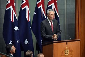Prime Minister Lee Hsien Loong, speaks to members and senators of the Australian government at the Parliament House in Canberra.