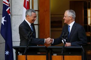 Prime Minister Lee Hsien Loong (left) shakes hands with his Australian counterpart Malcolm Turnbull during a joint press conference at Parliament House in Canberra.