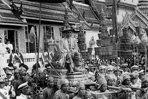 Thai King Bhumibol Adulyadej being carried by a cortege during the coronation ceremony in Thailand on May 5, 1950.