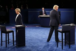 Mrs Clinton and Mr Trump at the second presidential debate on Sunday. The vitriolic war between the two threatens to hurt the reputation of the United States abroad, and has already likely damaged domestic political discourse for some time to come.