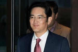 Samsung heir Lee Jae Yong seen arriving for a company event at the Shilla Hotel in Seoul on Jan 19, 2015.