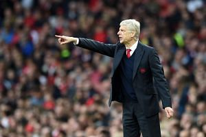Arsenal's manager Arsene Wenger gives instructions to his players during the match.
