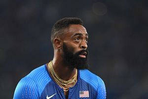 This file photo taken on Aug 19, 2016 shows USA's Tyson Gay looks on after Team USA was disqualified in the Men's 4x100m Relay Final during the athletics event at the Rio 2016 Olympic Games at the Olympic Stadium in Rio de Janeiro.