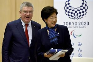 IOC president Thomas Bach and Tokyo governor Yuriko Koike speaking to reporters after their meeting about the 2020 Tokyo Olympic Games, in Tokyo on Oct 18, 2016.