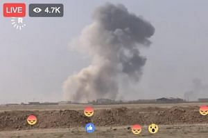 A screengrab of a live video feed showing the attack by Iraqi security forces on the ISIS-held Mosul.