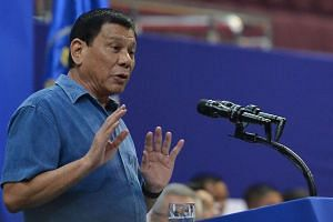 Philippine's President Rodrigo Duterte delivers a speech to Philippines nationals living in Brunei during his official visit at the Hassanal Bolkiah Indoor Sport Complex.