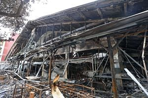 The gutted shell of the wet market at Block 493, Jurong West Street 41, after it was engulfed in a fire last Tuesday.