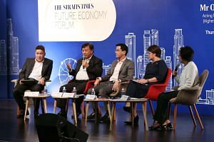 (From left)  Mr Max Loh, Sim S. Lim, Dr Kelvin Loh, Ms Goh Swee Chen and Ms Lee Su Shyan at the Straits Times Future Economy Forum on Oct 20, 2016.