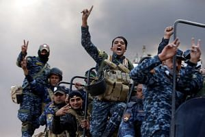 Iraqi security forces gesture in Qayyarah, during an operation to attack ISIS militants in Mosul, Iraq, Oct 19, 2016.