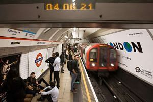 Commuters wait for a London Underground train at Oxford Circus station in central London on Aug 20, 2016.