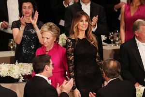 Mrs Hillary Clinton walks by Mrs Melania Trump while attending the annual Alfred E. Smith Memorial Foundation Dinner at the Waldorf Astoria on Oct 20, 2016 in New York City.