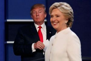 The rival candidates at Wednesday's presidential debate at the University of Nevada, Las Vegas. Mrs Clinton baited Mr Trump into a series of damaging nails-in-the-coffin statements, by continuing to deploy lethal darts from her team of shrinks, says one w