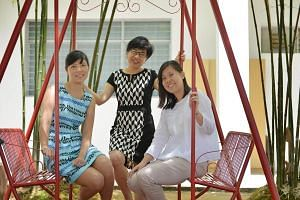 Anglican High School's principal Maureen Lee (centre) with teachers Audrey Chua (in white) and Lee Yilian.