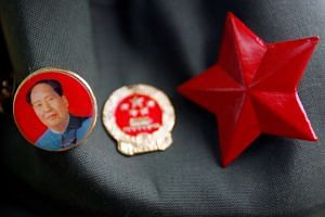 A Chinese Communist Party badge is seen at a market in Beijing.