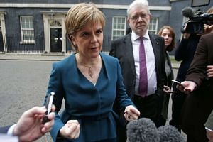 Scottish First Minister Nicola Sturgeon gestures as she speaks to members of the media outside 10 Downing Street in central London on Oct 24, 2016 after holding talks with British Prime Minister Theresa May.