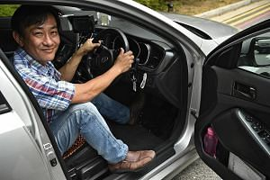 Taxi driver Hong Yong Ming uses a left-foot accelerator to operate the car. He lost control over movements on the right side of his body after a stroke six years ago.
