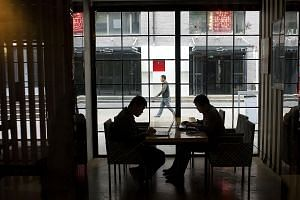 Internet start-up employees working in a cafe in Beijing. The Chinese government's plan to rate people and businesses is officially aimed at fighting fraud, but critics say accumulating so much data on individuals is a move towards a totalitarian soc