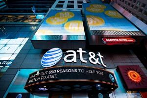 An AT&T sign is displayed at its store in the Time Squares area of New York.
