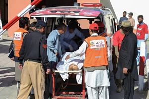Pakistani rescue workers transport an attack victim, after a terrorist attack on a police academy, in Quetta on Oct 25, 2016.