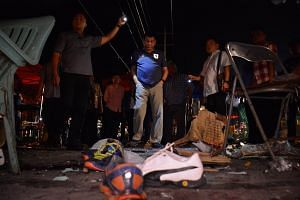 Philippine President Rodrigo Duterte inspecting the site of a bombing at a night market in Davao, southern Philippines, on Sept 3, 2016.