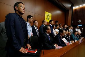 Pro-Beijing lawmakers meeting with the media after staging a walk-out to stall the swearing in of two legislator-elects in Hong Kong's Legislative Council on Oct 19, 2016.