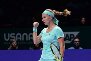 Svetlana Kuznetsova of Russia reacts as she plays against Agnieszka Radwanska of Poland during their women's singles match at the WTA Finals tennis tournament in Singapore on Oct 24, 2016.