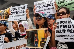 Protesters from Indonesian migrant worker organisations outside the High Court at the start of the trial of British banker Rurik Jutting in Hong Kong on Oct 24, 2016.