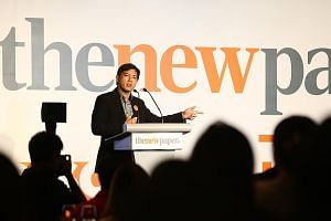 Left: Mr Wee, who currently oversees the coverage of local news at The New Paper, will take over as its new editor on Dec 1. Far left: At the TNP trade launch yesterday, the new look of the paper was unveiled. The launch on Dec 1 will also include a
