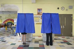 People vote in the Pennsylvania state primary election at a polling site in North Philadelphia, in Philadelphia, Pennsylvania, USA, on April 26, 2016.