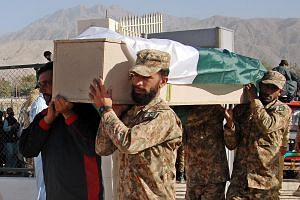 Pakistani soldiers on Tuesday carrying a coffin with the body of one of the cadets who were killed when militants attacked a police academy in Quetta on Monday.