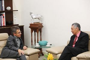 PM Lee during the interview last Thursday with Time magazine's Mr Bremmer. Mr Lee said that while change cannot be stopped, the Government can help in training, transition assistance and social support if people are out of a job.