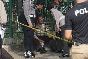 Police officers at a police post in Tangerang, near Jakarta, where a jobless 21-year-old man attacked two officers with knives and pipe bombs last Thursday. The ISIS-linked suspect was shot by a third police officer and died en route to hospital.