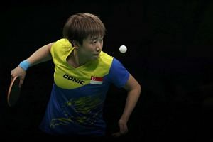 Feng Tianwei eyes the ball during play against Ai Fukuhara of Japan at the 2016 Rio Olympics on Aug 9, 2016.