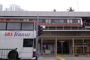 Train at the MRT station and SBS bus at traffic junction in Ang Mo Kio on Jan 21, 2015.