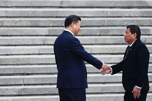 Chinese President Xi Jinping (left) welcoming Mr Duterte in Beijing last week. The Philippines' realignment to China serves to turn Asean centrality on its head, says the writer.