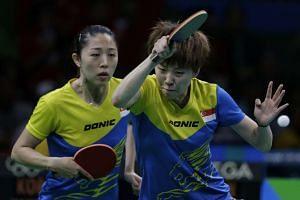 Yu Mengyu (left) and Zhou Yihan of Singapore in action against Korea during the Rio 2016 Olympic Games table tennis women's team quarter-final at Riocentro Pavilion 3 in Rio de Janeiro, Brazil, on Aug 13, 2016.
