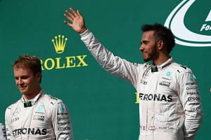 Lewis Hamilton of Great Britain and Mercedes GP and Nico Rosberg of Germany and Mercedes GP celebrate on the podium during the United States Formula One Grand Prix at Circuit of The Americas on Oct 23, 2016 in Austin, United States.